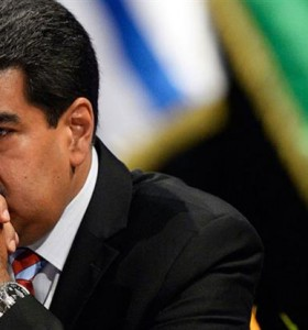 """Venezuela entra en """"default parcial"""" por incumplir pago de deuda"""