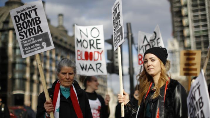 May defendió el ataque a Siria